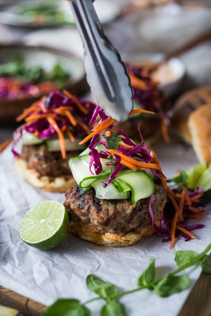 A Delicious recipe for Thai Turkey Burgers- with lemongrass, ginger & basil, topped w/ a Crunchy Asian Slaw and Spicy Aioli. Light, healthy, FLAVORFUL! Easy to make.   www.feastingathome.com #thaiturkeyburger #thaiburger #turkeyburger