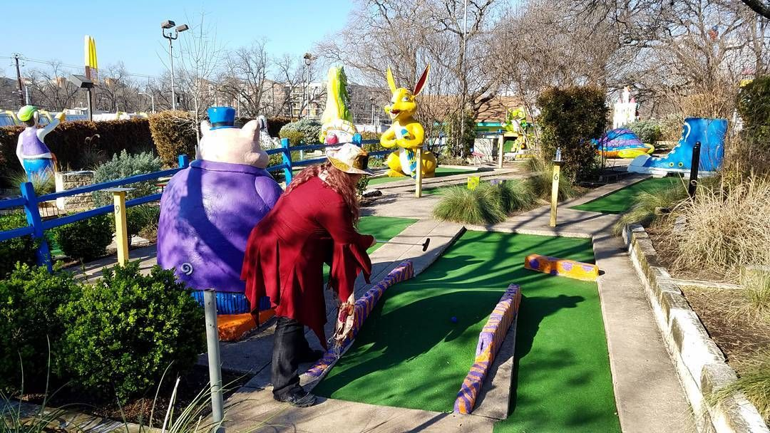 She takes the shot at Peter Pan Mini Golf in Austin TX.