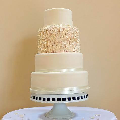 Understated, elegant ivory wedding cake with one textured tier.