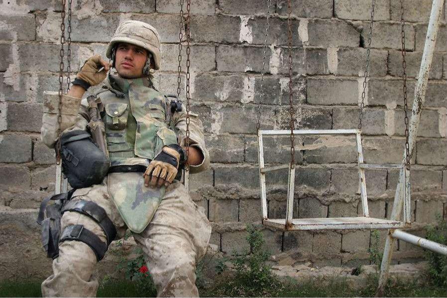 A Us Marine Takes A Break During The Battle Of Fallujah Iraq