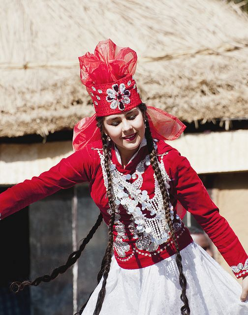 The traditional dress of the Tajik women is long shapeless attire prepared with brilliant and showy color patterns along with the matching pants. The dress was usually accompanied with the embroidered traditional shoes.  Some women also use Scarf or Hijab in order to cover their head or neck.