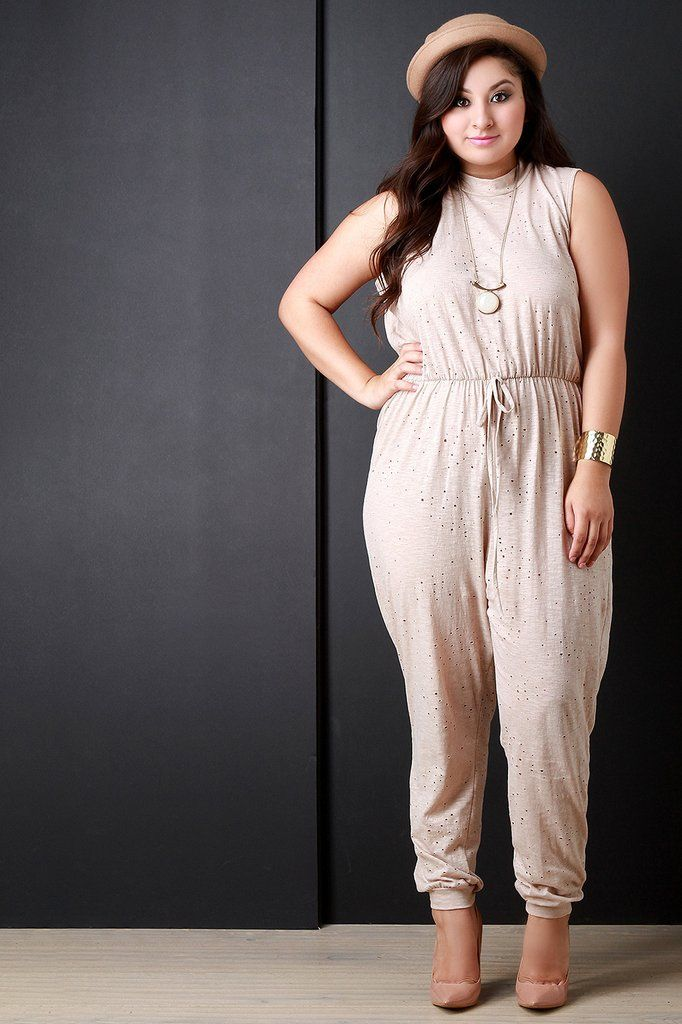 2ceb325b8677 This stylish plus size jumpsuit features a distressed hole pattern design