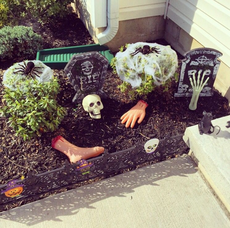 Dollar tree Halloween decor to turn your flower bed into a
