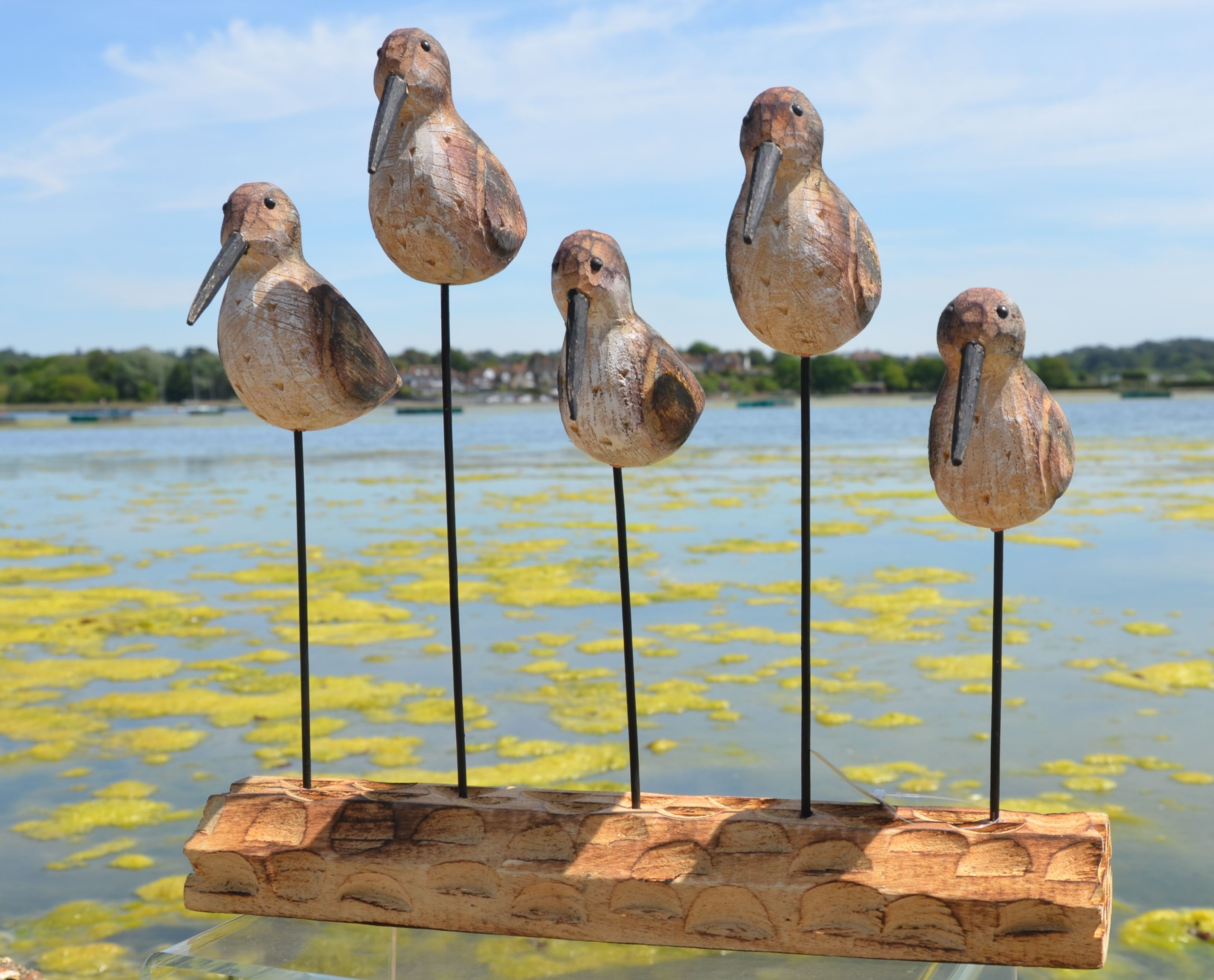 We love these birds and the base they stand on, but they're facing away from our beautiful lake in Poole, as the tassleweed has returned and if the weather heats up it's going to get worse. So they are facing away and preparing for flight!....perhaps a new location to look beautiful in.  www.dorsetgifts.com