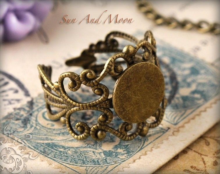 20 Fancy Vintage Design Filigree Ring Bases - Adjustable Rings - 10mm Pad Ring Blanks - Mix and Match - FRB. $10.00, via Etsy.