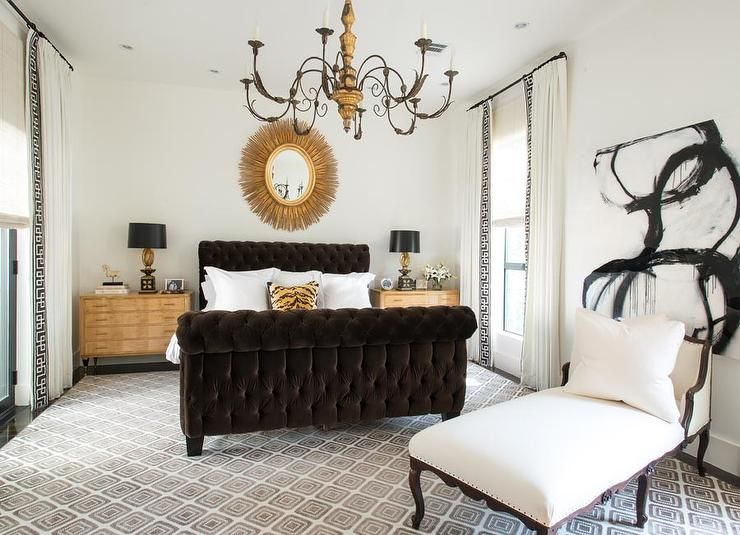 exciting gold brown bedroom decorating ideas | Chic bedroom features a gold oval sunburst mirror hanging ...