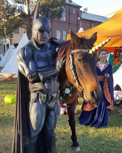 """""""Time travelling Batman avec unicorn"""" one of the many wonders witnessed last weekend by @kapowcomicbookshow at the Winterfest medieval fair at Parramatta. Check out our upcoming profile and #GameofThrones review in an upcoming episode on our YouTube channel.  #Batman #unicorn #Winterfest #medievalfestival #medievalfair #horses #Parramatta #NSW #Sydney #Australia #oldstuff #GameofThrones #GoT #capedcrusader #cosplay #costuming #fairday #westernsydney"""