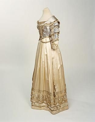 "Fancy dress costume, England, 1826: This dress was worn by Sarah Coke, who lived at Brookhill Hall, Pinxton, Derbyshire, at a fancydress ball in Nottingham in 1826. It was Sarah's ""coming out"" ball, her first social event as an adult, and the dress was supposed to represent the fashion of Charles II's time, and she wore her hair in ringlets, adorned with white ostrich feathers. Manchester Art Gallery."