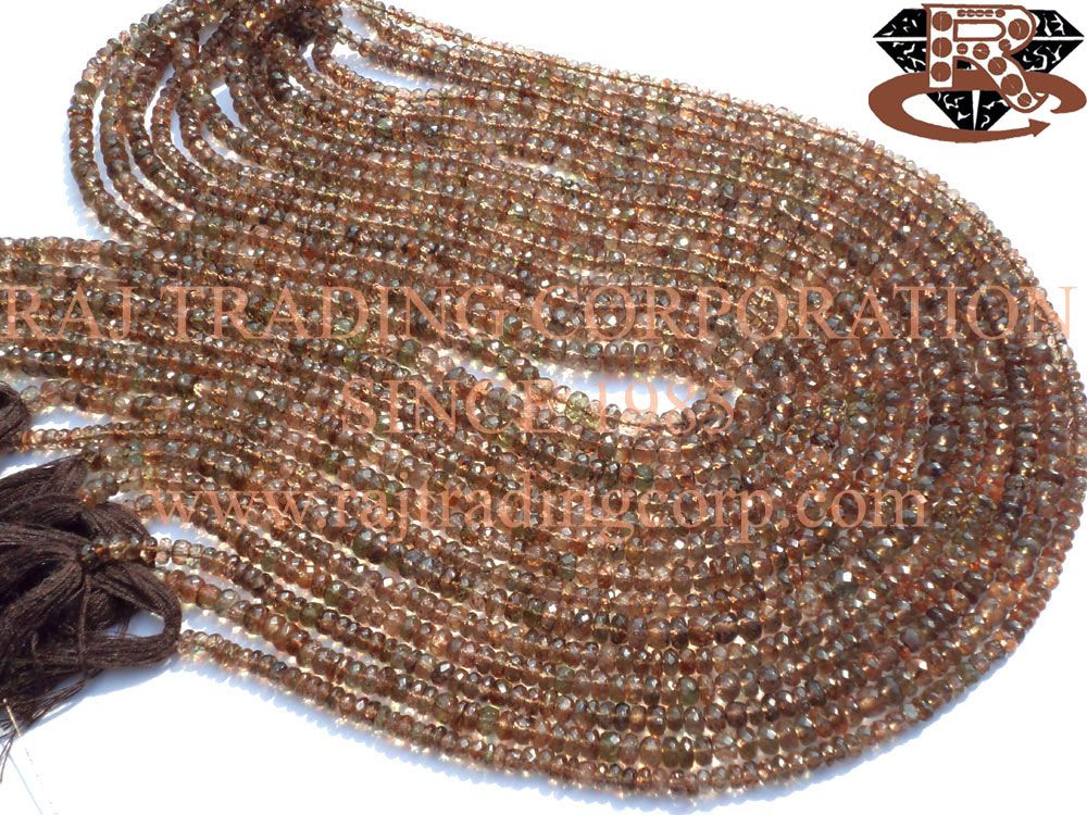 Andalusite Faceted Roundel (Quality AAA) Shape: Roundel Faceted Length: 36 cm Weight Approx: 15 to 17 Grms. Size Approx: 4.5 to 5.5 mm Price $63.30 Each Strand