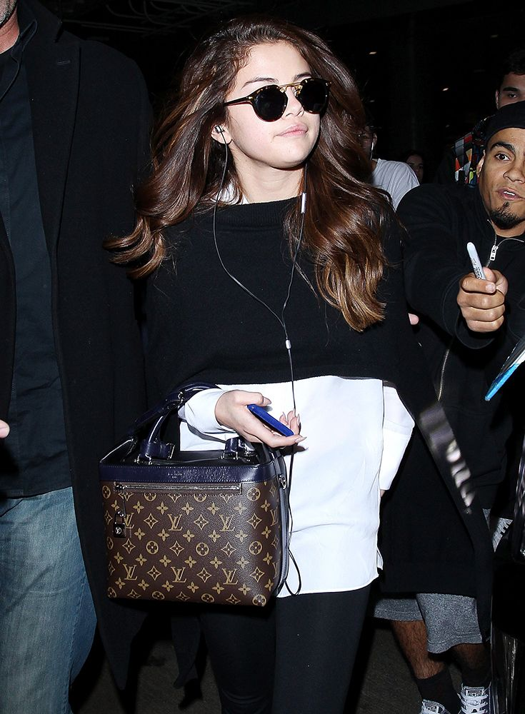 Selena Gomez Wins Our Handbag Exclusivity Contest This Week Because It S Always A With Logo D Louis Vuitton Satchel That Hot Off The Paris