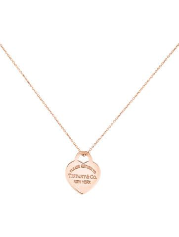 9efeccf739db Rubedo Tiffany   Co. rolo chain necklace with Return To Tiffany Heart Tag  pendant featuring engraved logo and spring ring clasp closure.