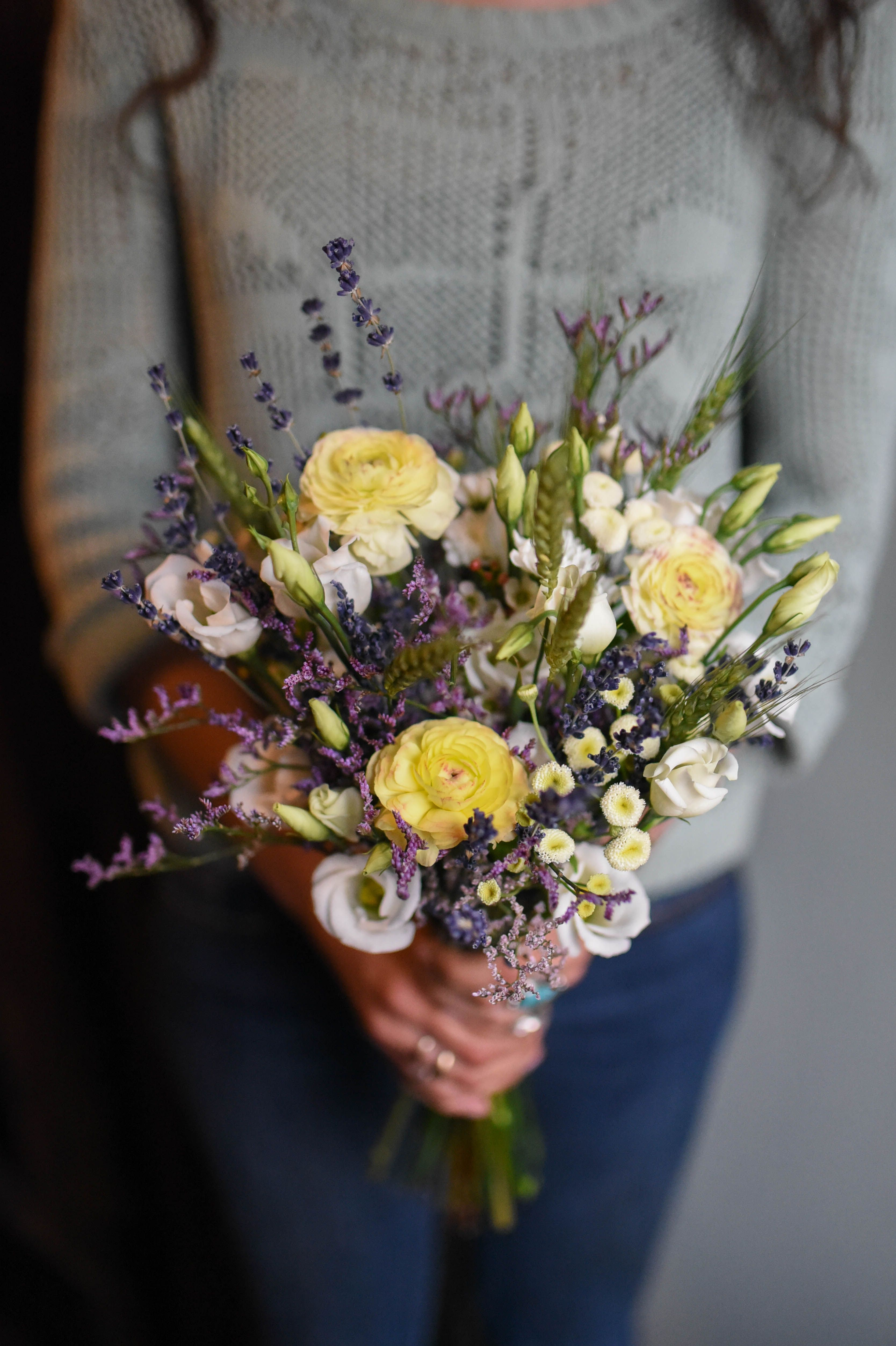 Seaside wildflower wedding bouquet featuring wheat