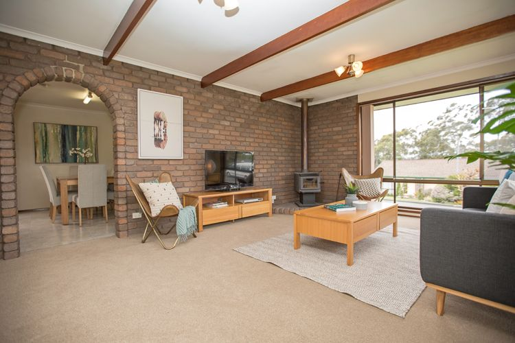 Small lounge room, brick feature wall, freestanding fireplace ...
