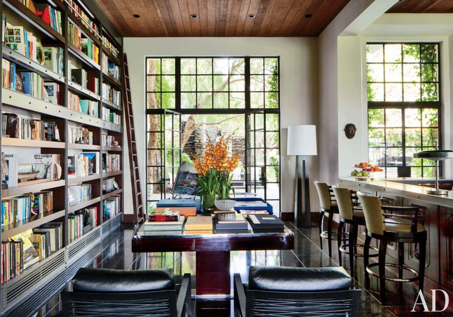This contemporary living room with a builtin bookshelf full of