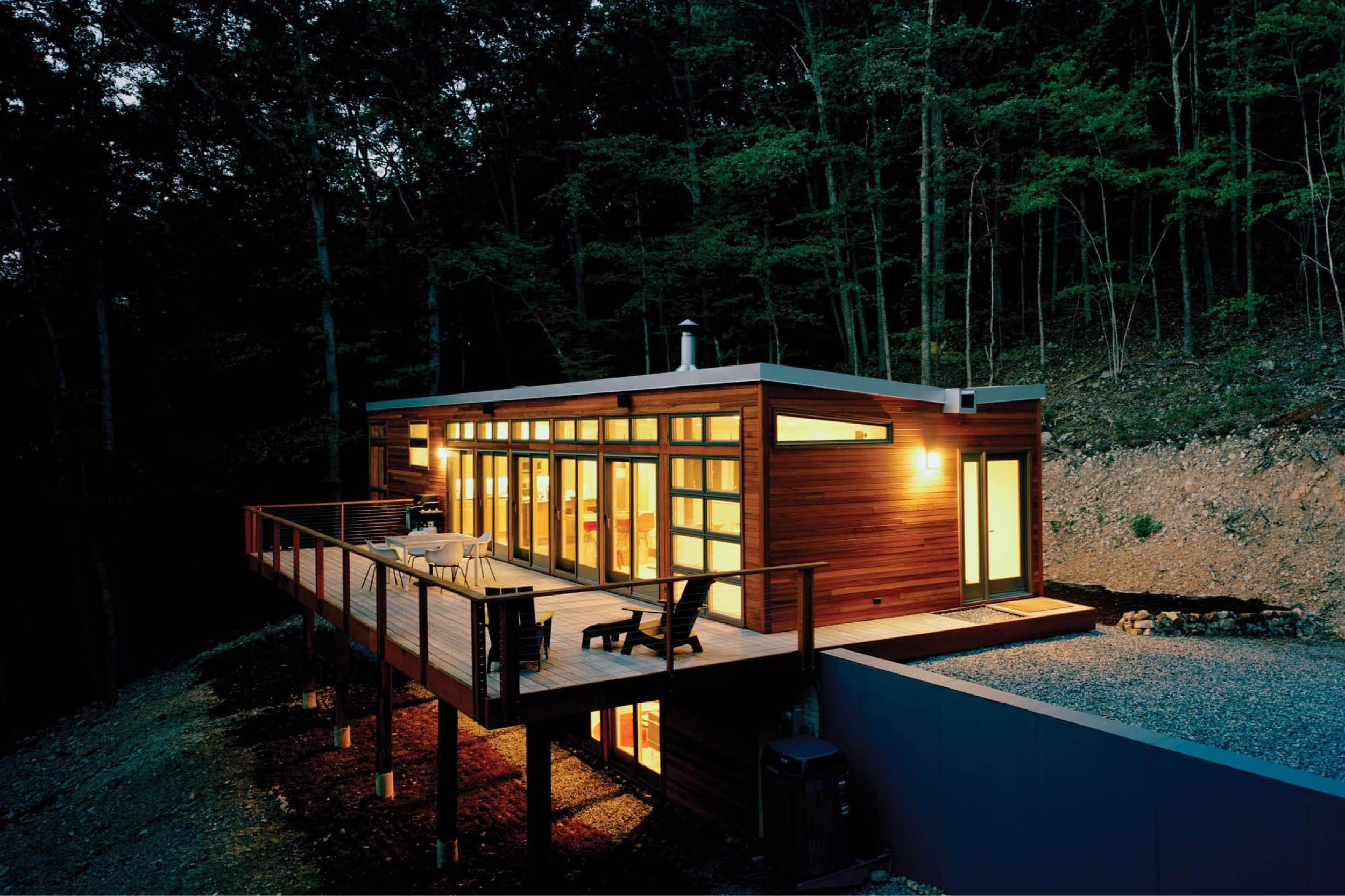 Modern modular prefab house steep site butterfly roof cedar siding deck cable rails res4 west virginia