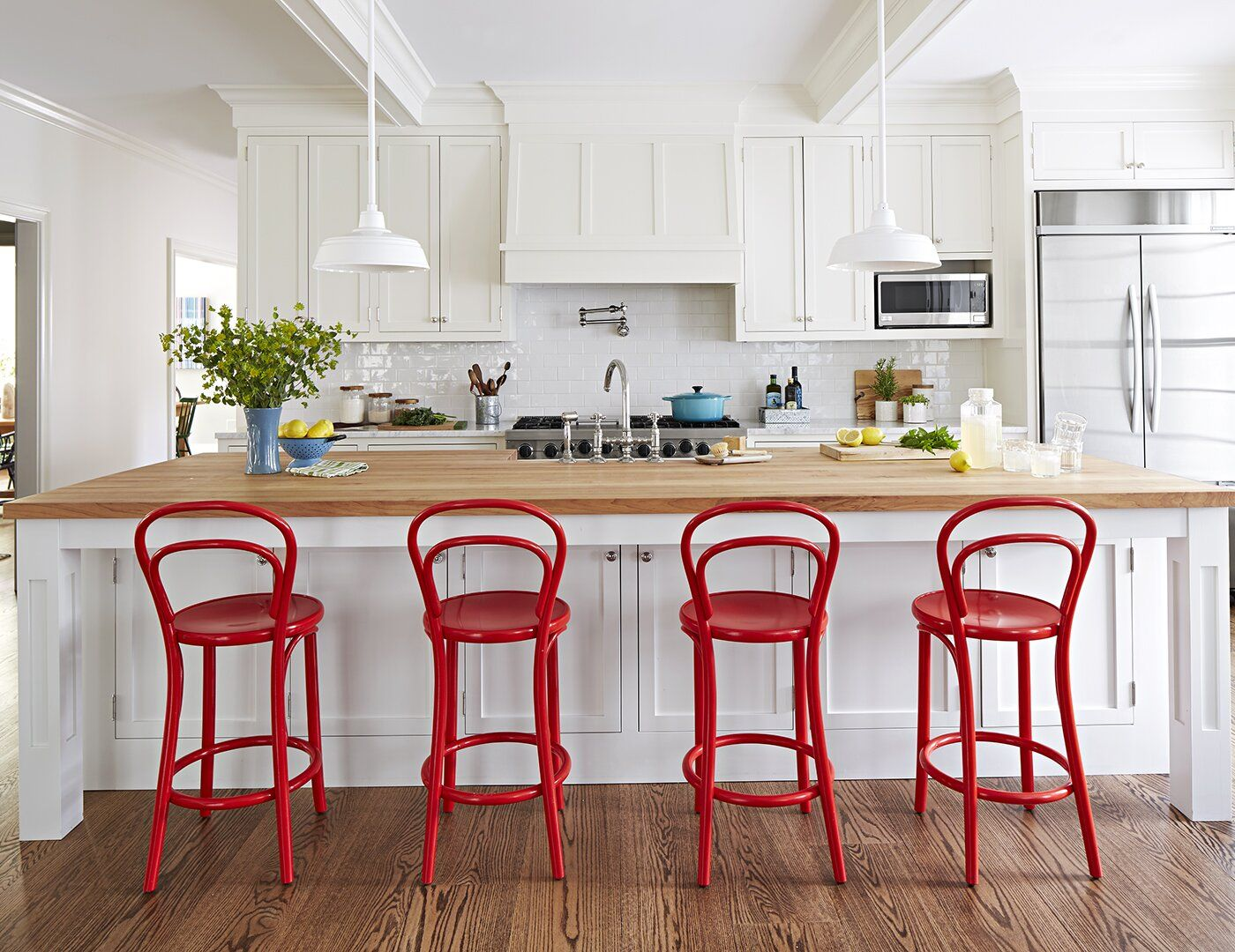 We Love This Home S Colorful Twist On Modern Farmhouse Style White Wood Kitchens Modern Farmhouse Style Large Kitchen Island Red kitchen island with stools