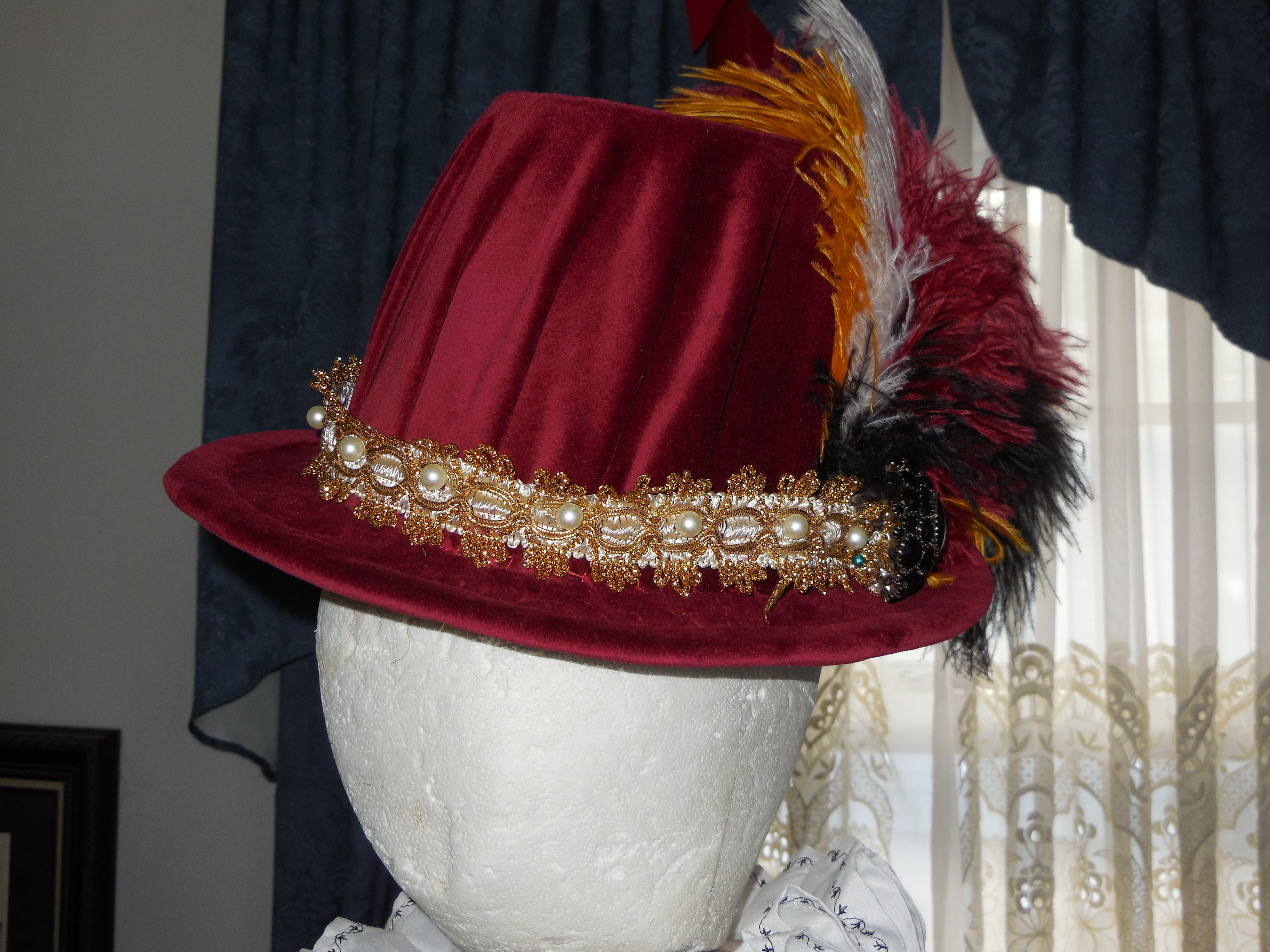 b2d2ea87bf6 Front view of an Elizabethan Tall Hat with a Knife Pleated Crown. Hatband