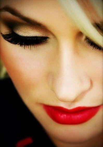 makeup. red lips, brown gold eyes