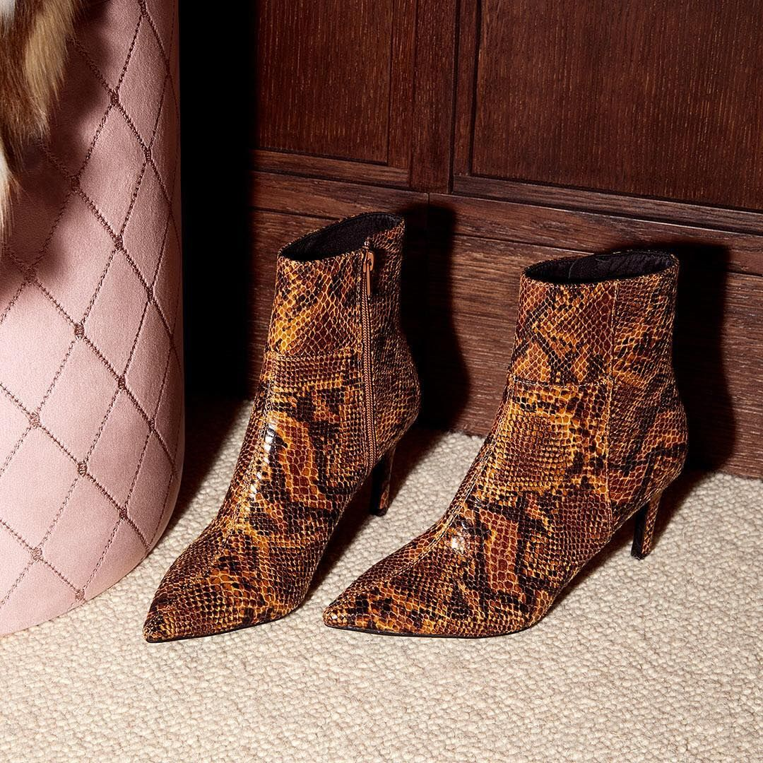 f4d8d02aaa2 These snakeskin-patterned boots were made for looking fabulousss ...