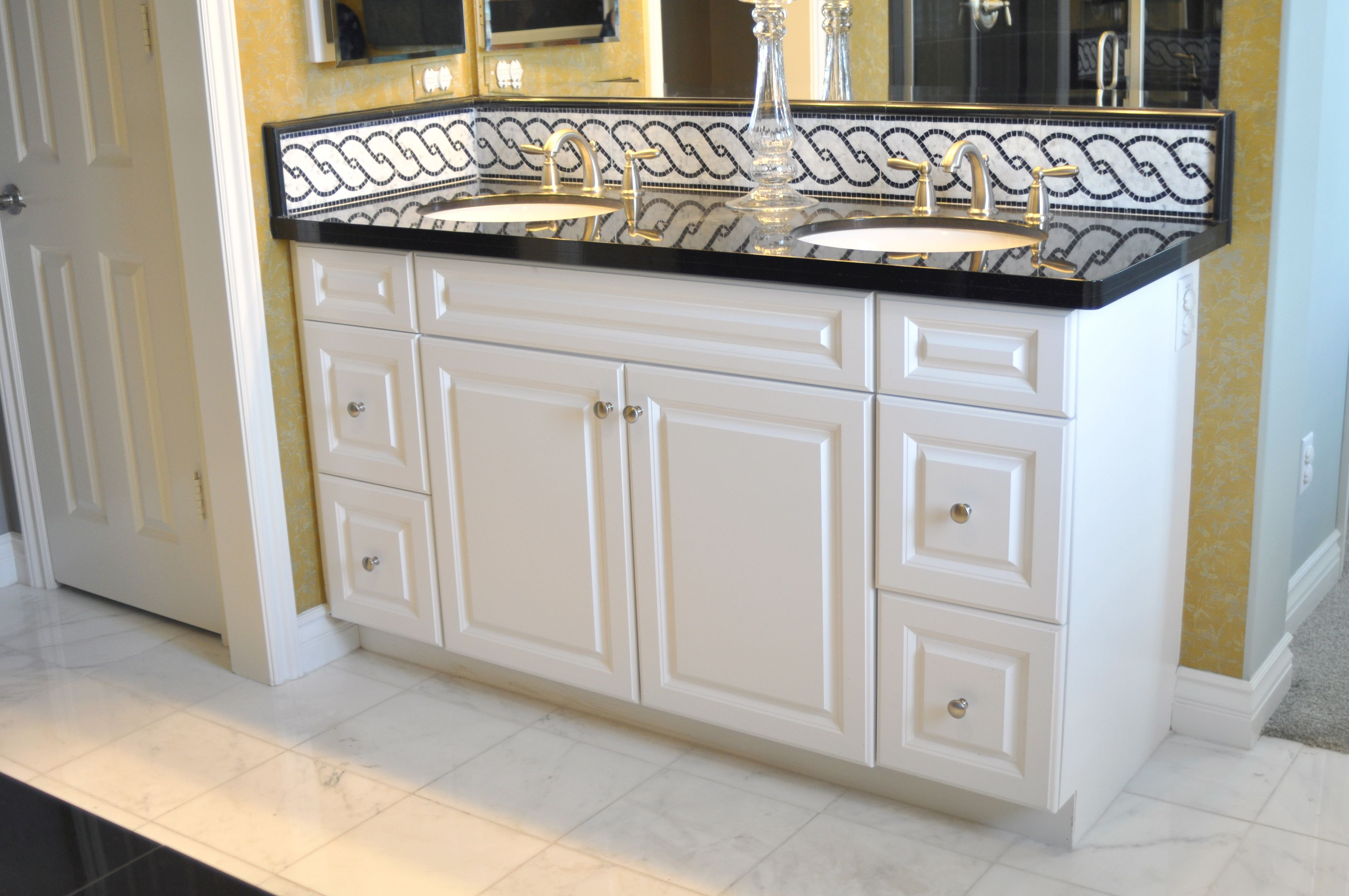 Thermofoil bathroom vanities - Hamilton Thermofoil Door Style With A White Finish Featured In A Bathroom