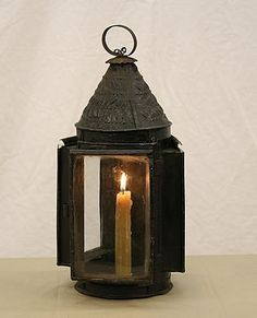 Old candle in a lamp