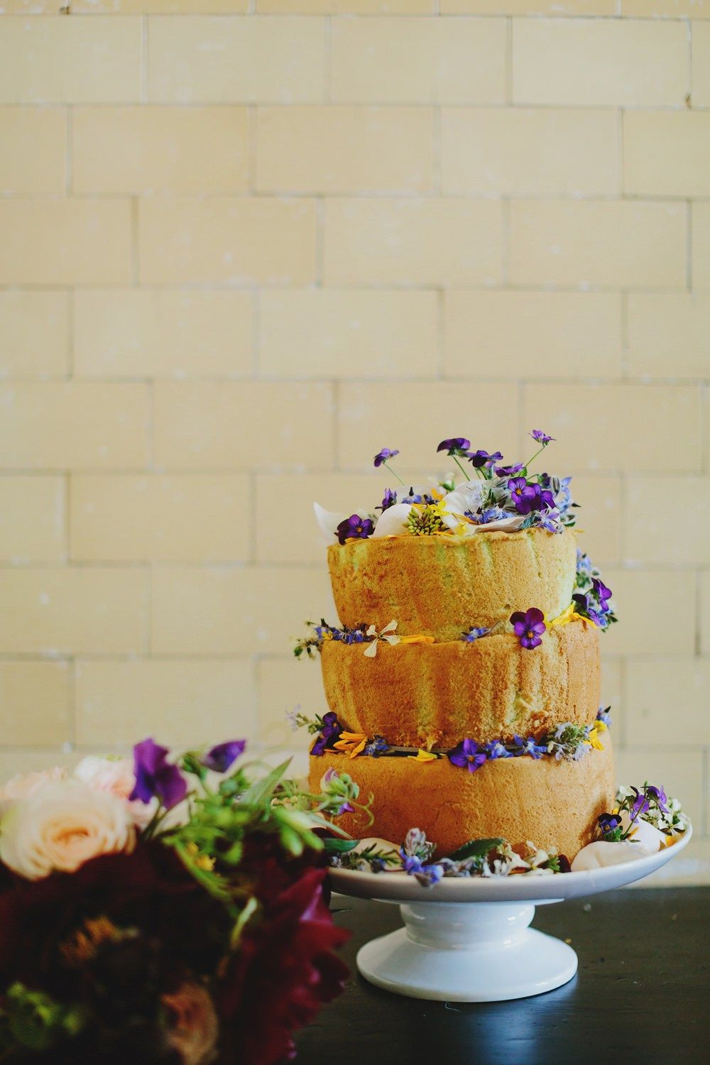 three-tiered Malaysian pandan (screwpine leaf extract) coconut chiffon cake decorated with pansies and violas | fabmood.com #wedding #rusticwedding #factorywedding