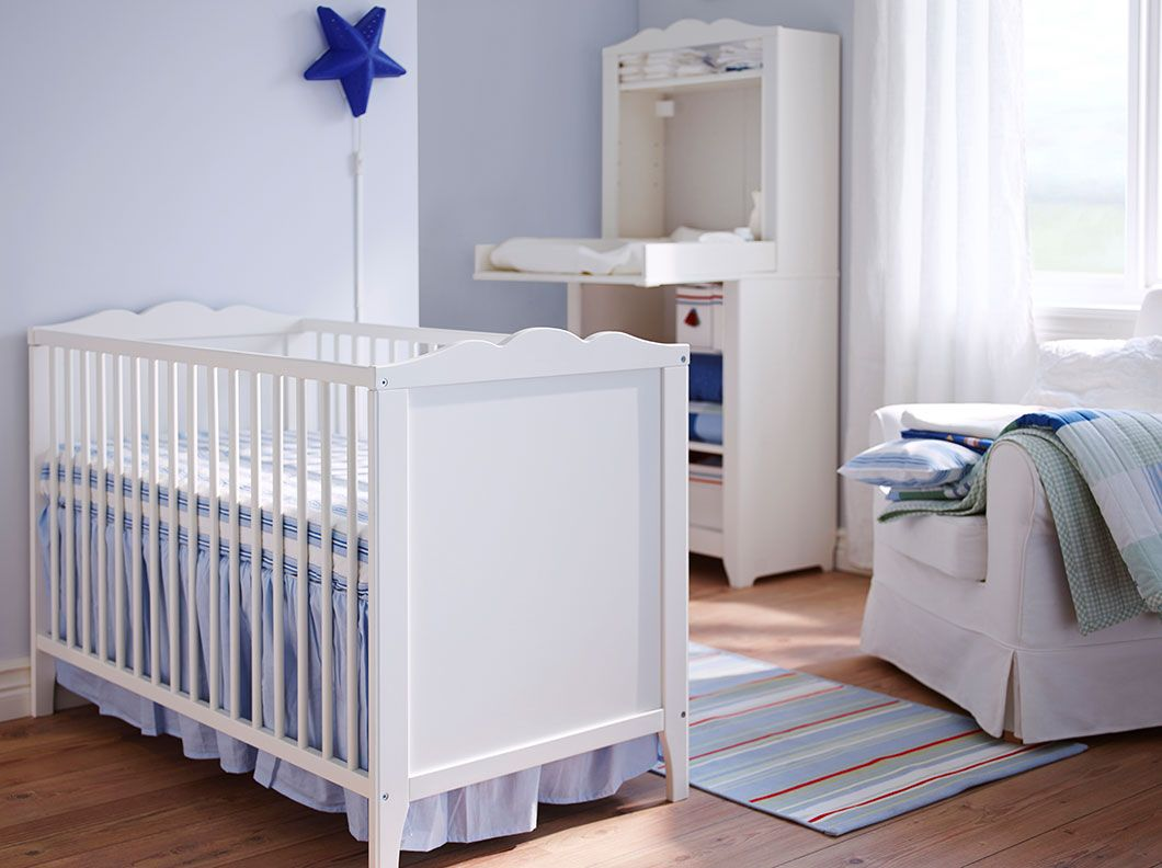 A White Baby Cot With Matching Changing Table From Ikea