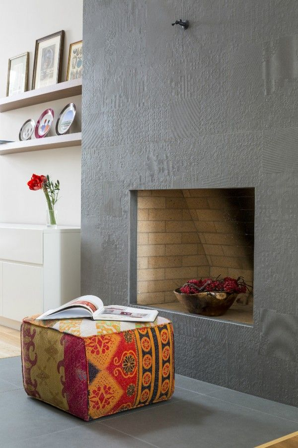 Apartmentultra textured fireplace two modern apartments with perfectly placed bursts of colors a vase
