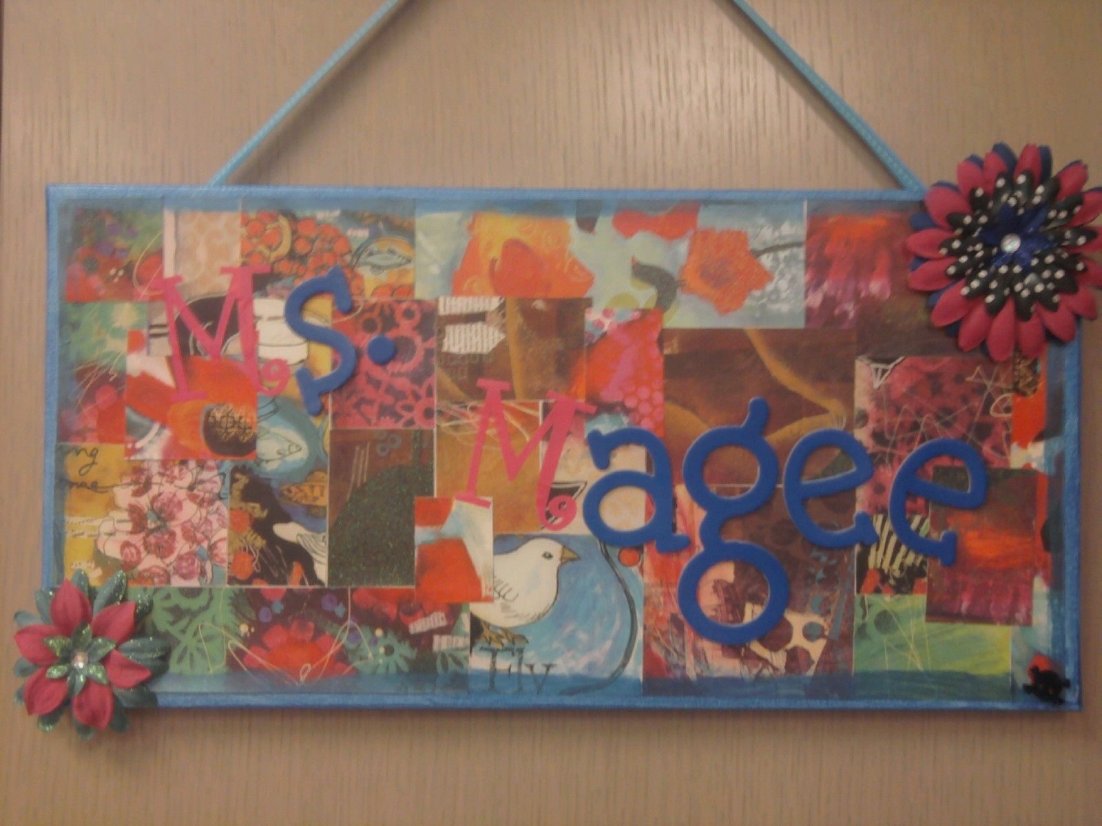Sign I made for my classroom door.  Decoupaged scrap book paper, paint, flowers, etc.