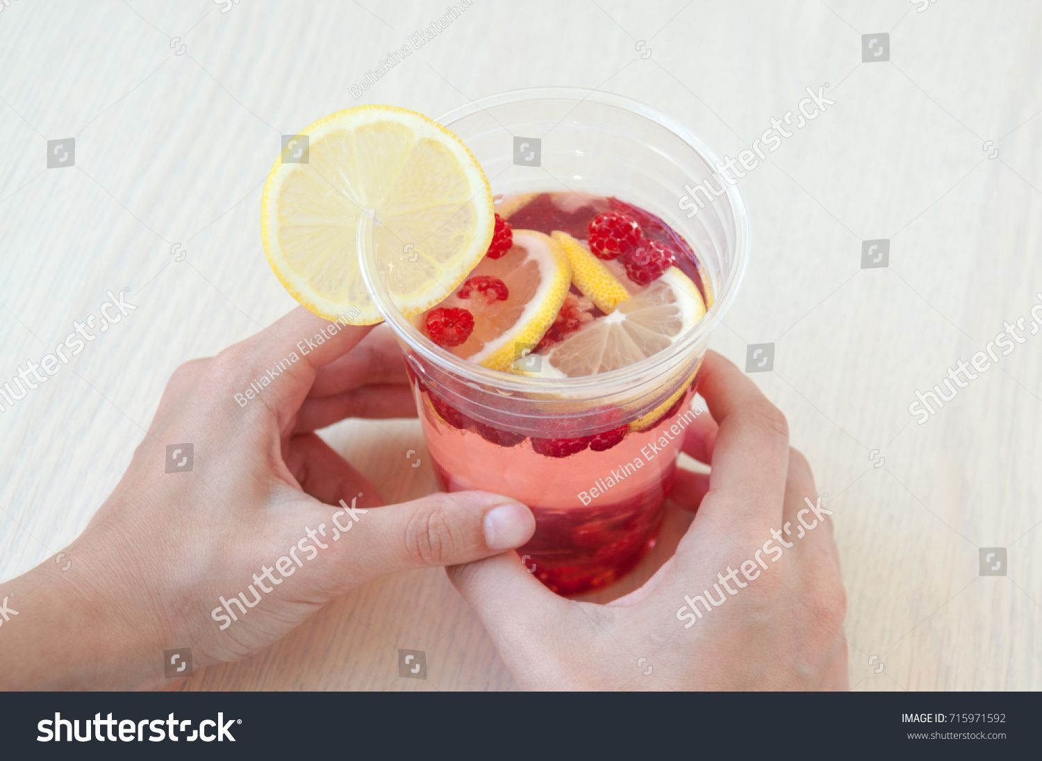 Female Hands Hold Glass With Drink Of Lemon And Raspberry Ad Sponsored Hold Hands Female Glass In 2020 Drinks Glass Hold On