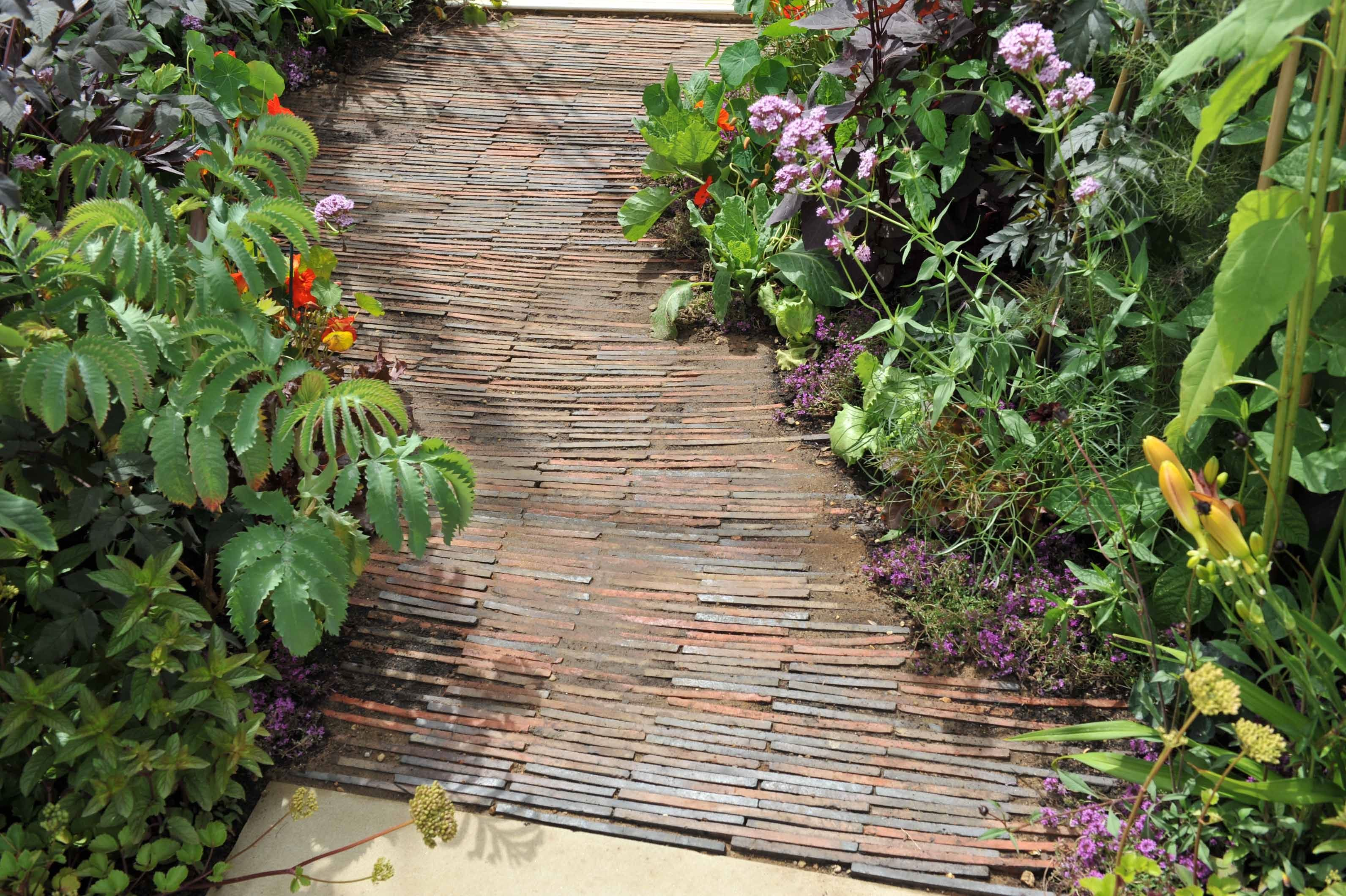 path is paved using old roof tiles