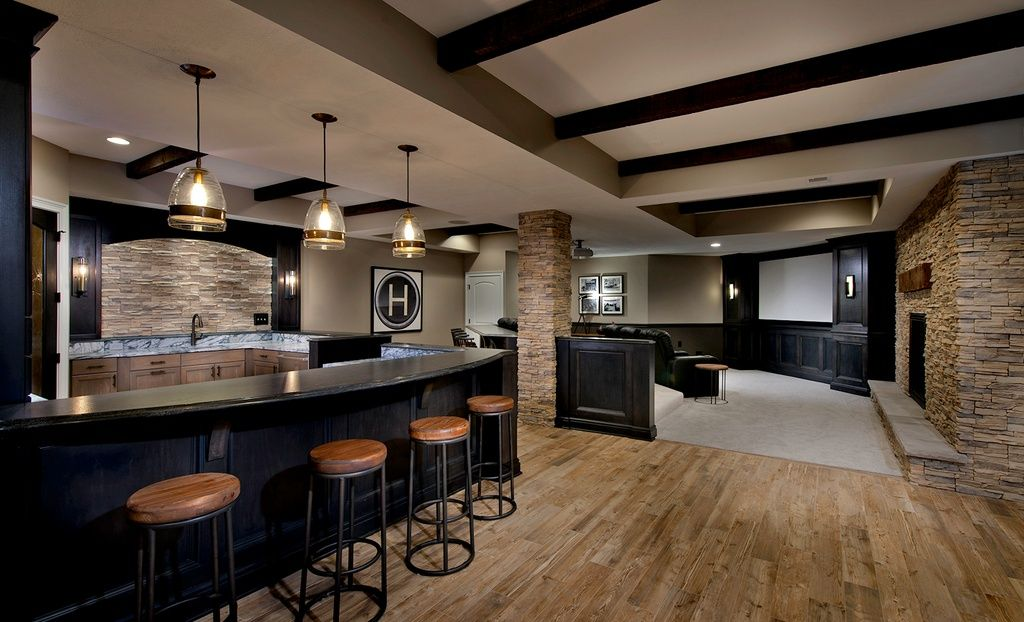 Transitional Basement With Wet Bar Stone Fireplace And