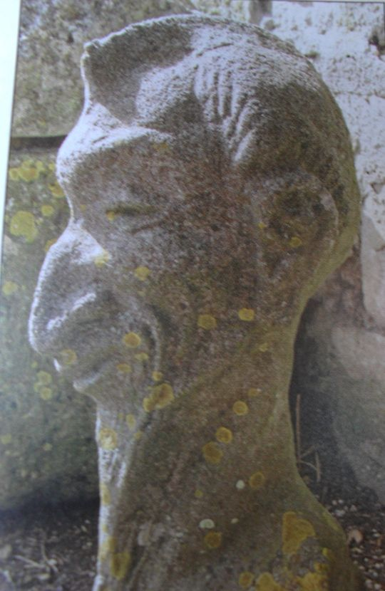 "Mysterious stone head allegedly made of granite and currently in the garden of the U. K. Isle of Portland Museum possibly linked to Phoenicia. Note similarities to the ""CBE"". Earthfiles.com Real X-Files 