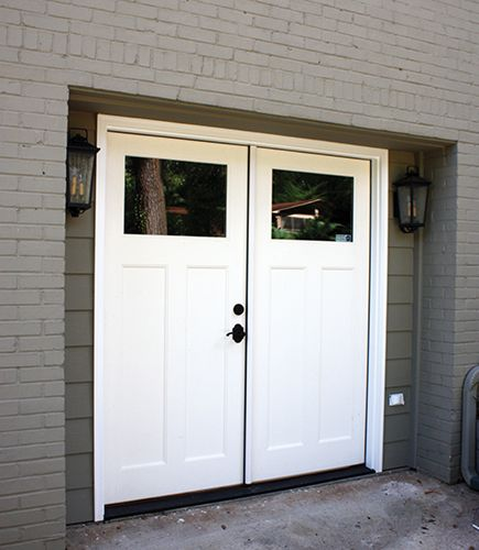 Double door garage conversion replace an overhead door for Convert two door garage into one