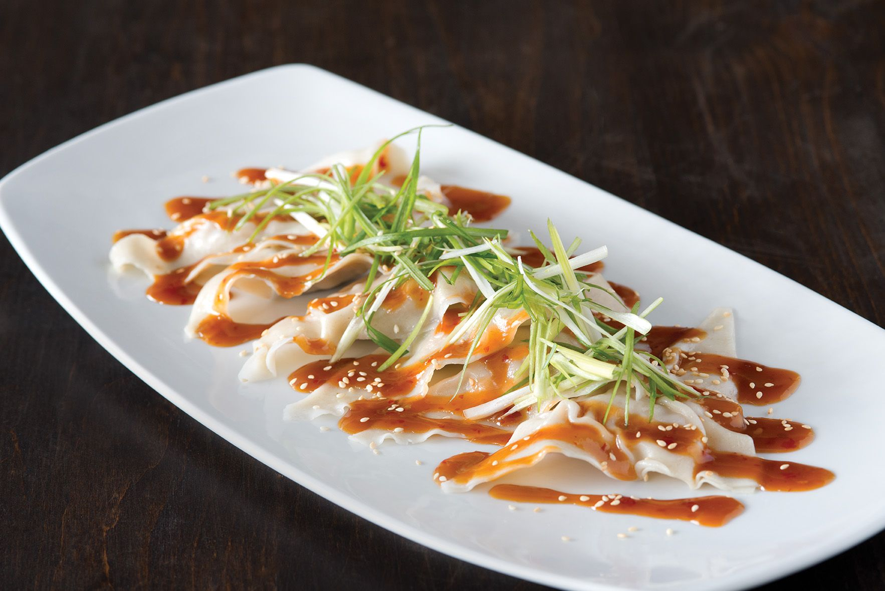 These Sesame Ginger Chicken Dumplings with soy-ginger chili sauce at ...