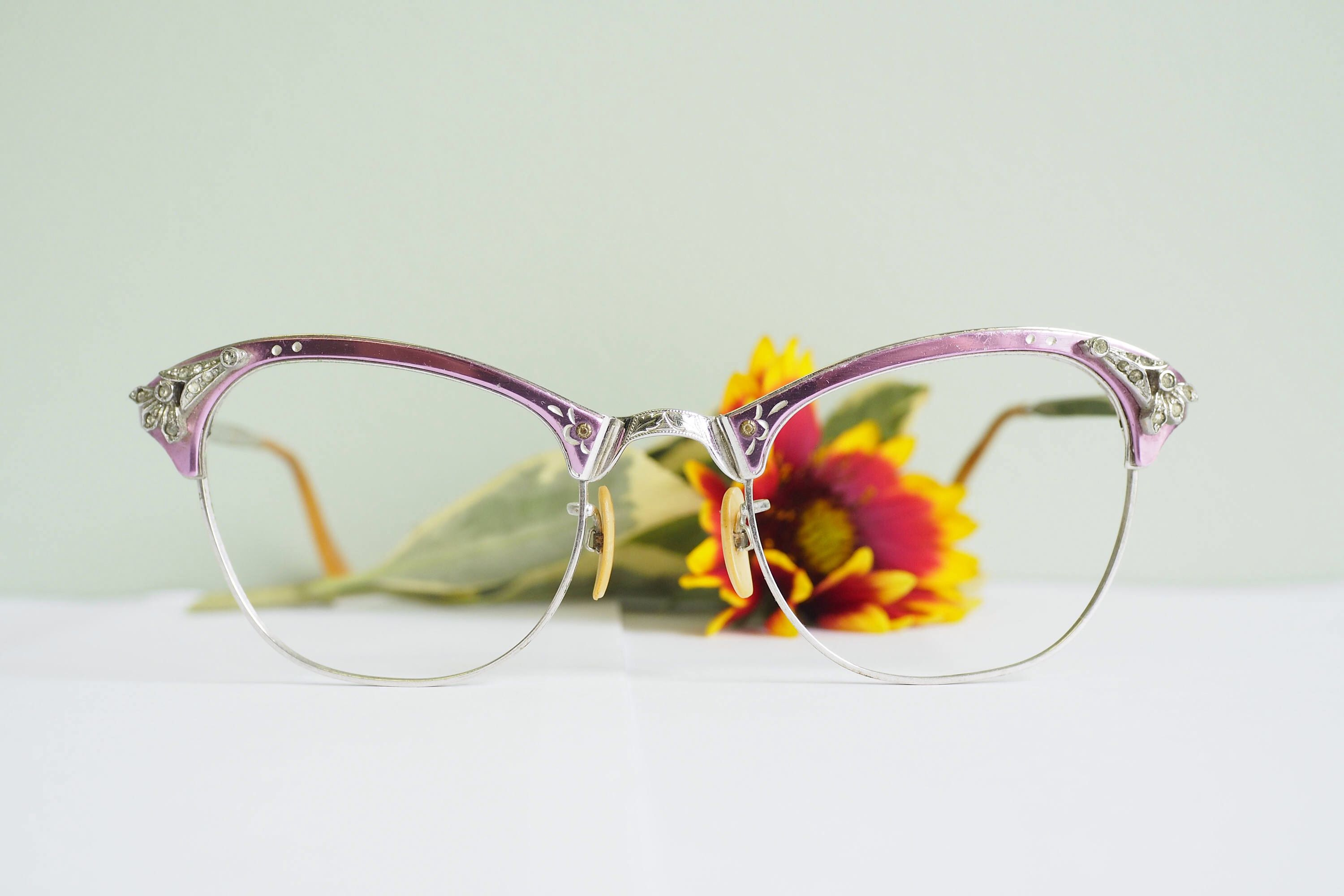 Vintage Cat Eye Frames 1960's Cateye Frames new Old Stock Glasses All aluminium Frame metallic Pink With Rhinestones 1/10  12K gold filled by hisandhervintage on Etsy https://www.etsy.com/listing/549019266/vintage-cat-eye-frames-1960s-cateye