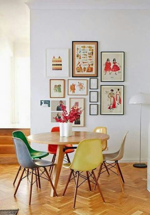 Colorful Dining Space With Multi Colored Charts And Bright Art Gallery Wall