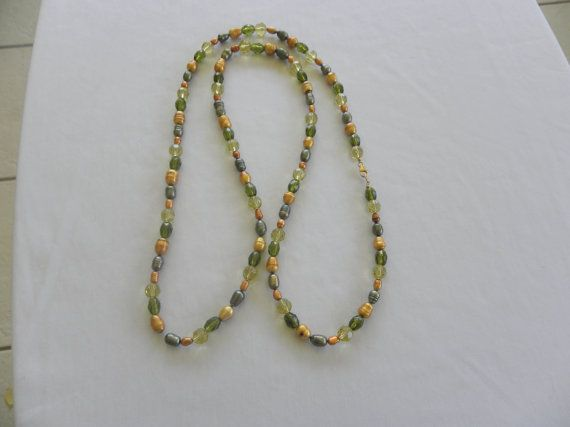 Necklace with freshwater green and gold pearls and by MaxLondon, $40.00