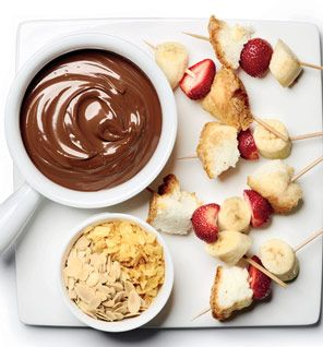 Spicy Chocolate Crackle Fondue INGREDIENTS 10 oz milk chocolate, coarsely chopped 4 1/2 oz semisweet chocolate, coarsely chopped 1 teaspoon vegetable oil 1/8 teaspoon cayenne pepper 2 tablespoons almonds, sliced 2 1/2 oz kettle chips, finely crushed Strawberries Bananas, cut into 1-inch pieces Angel food cake, cut into 2-inch squares