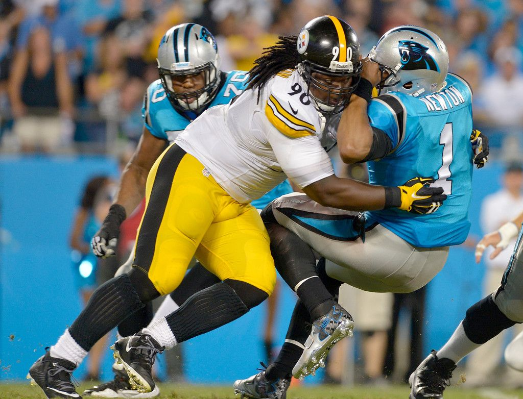Steve McLendon #90 of the Pittsburgh Steelers sacks Cam Newton #1 of the Carolina Panthers during their game at Bank of America Stadium on September 21, 2014 in Charlotte, North Carolina.