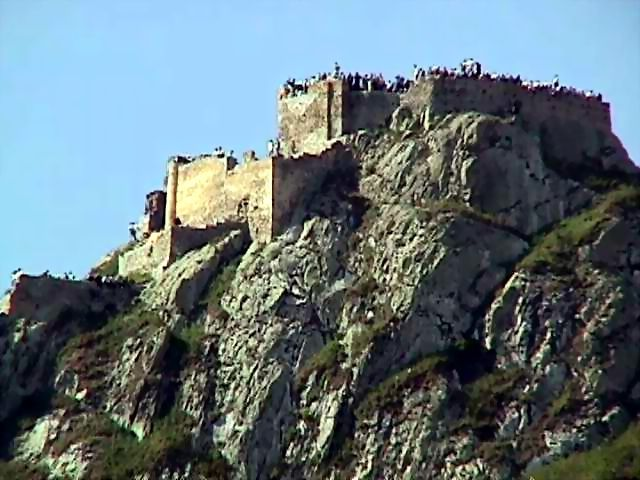 BABAK CASTLE, near Kalibar City, Iran. Also known as The Immortal Castle.   Built atop a mountain 2300-2600 meter high and surrounded by gorges as deep as 400 to 600 meters, this castle is believed to belong to the Parthian dynasty and modified under the Sasanid dynasty. To reach the castle, one has to trek a tortuous and narrow passageway and then cross a corridor-shaped temple 200 meters in length.
