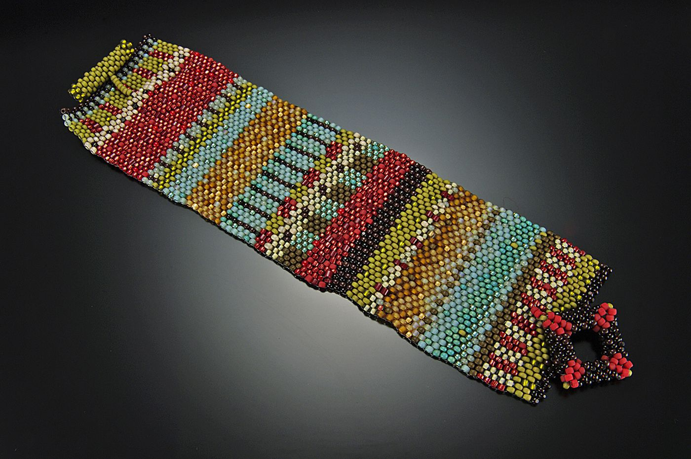Navajo Cuff - A beautifultapestry blanket that wraps your wrist $300 http://www.juliepowelldesigns.com/product/navajo-cuff/