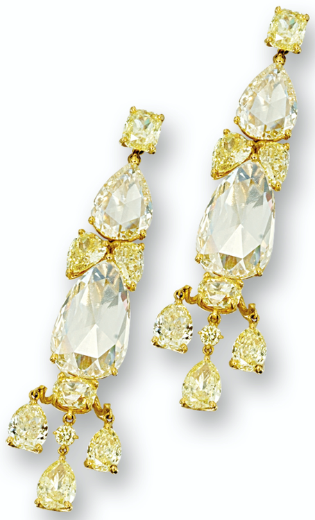 YELLOW DIAMOND PENDANT EARRINGS.        Each set with two pear-shaped rose-cut yellow diamonds altogether weighing approximately 16.95 carats, supporting a fringe of three pear-shaped diamonds, decorated by pear-, cushion-shaped and brilliant-cut yellow diamonds altogether weighing approximately 13.96 carats, mounted in 18 karat yellow gold. Sotheby's. (=)