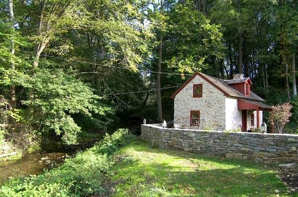 A Small Stone Cottage On Creek In Pennsylvania
