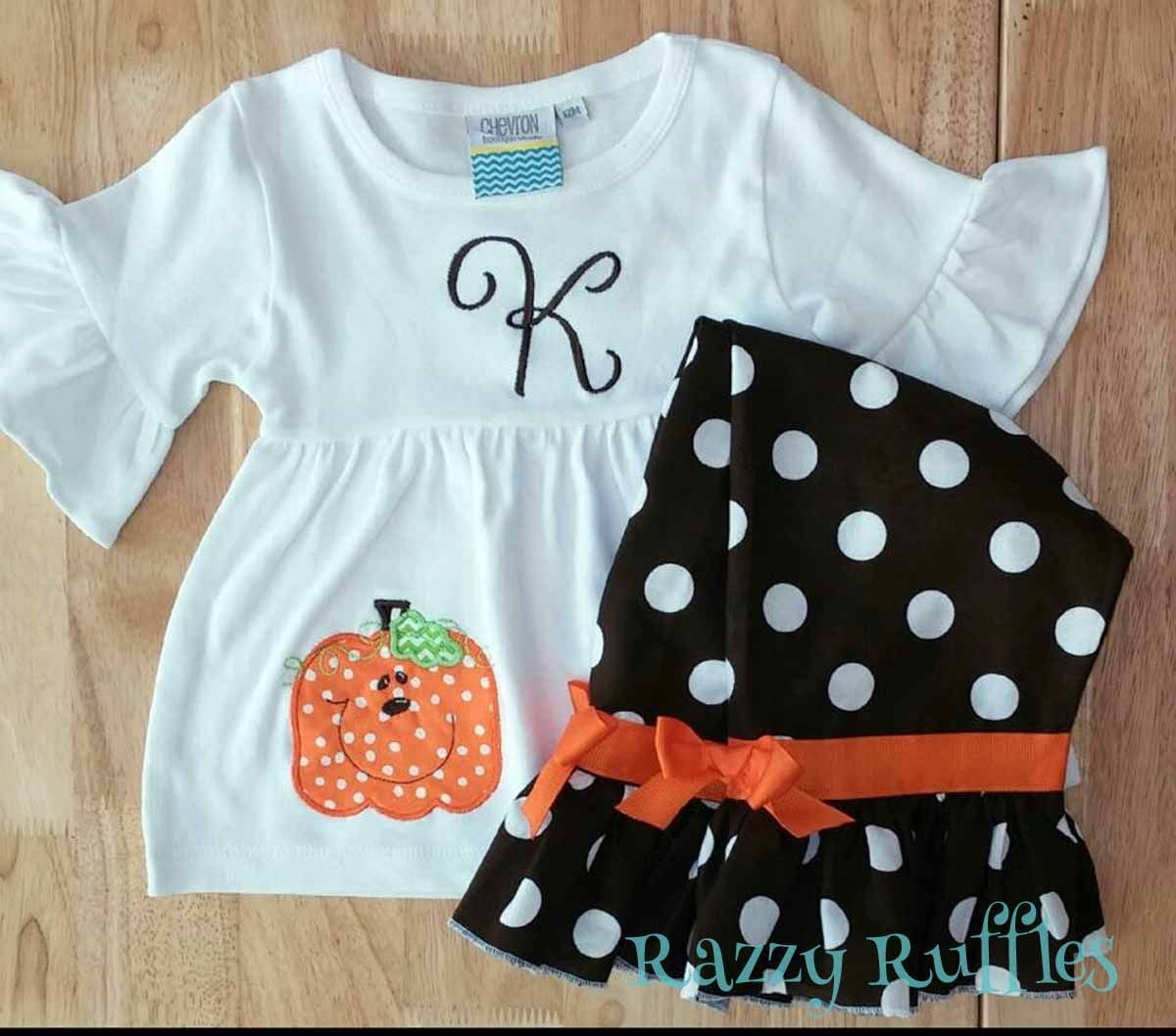 A personalized and pumpkin applique tunic and cute ruffle pants for fall. www.etsy.com/shop/razzyruffles.