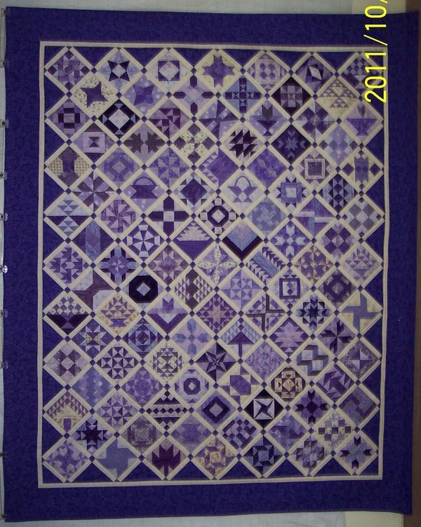 Purple Farmers Wife Quilt.  This is just a stunning quilt.  What a great looking monochromatic quilt using all purples.  My sister Sharon would have loved this quilt.