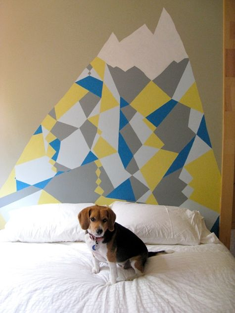 painted geometric headboard. so cool. this would need to be more symmetrical in my home though. it would drive me bananas.