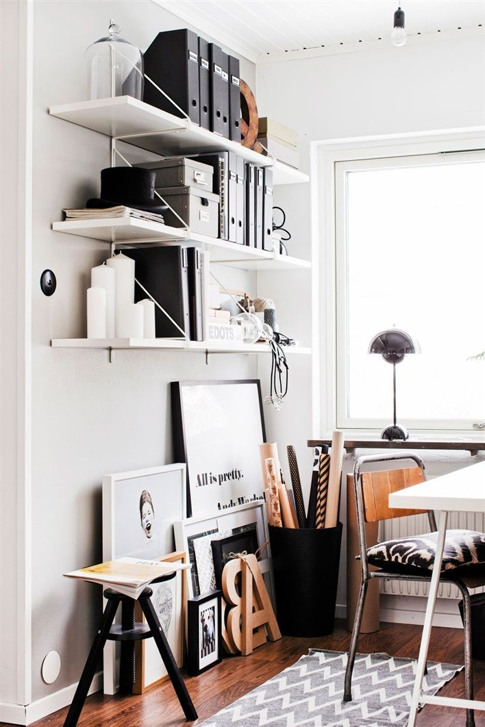 Black and white workspace with wooden accents