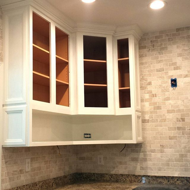 Cabinets raised to ceiling with open shelves added below ...