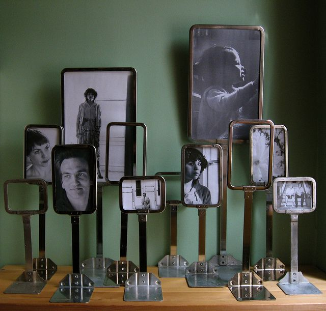 Repurpose old department store price display signs, or spatulas, as picture frames.